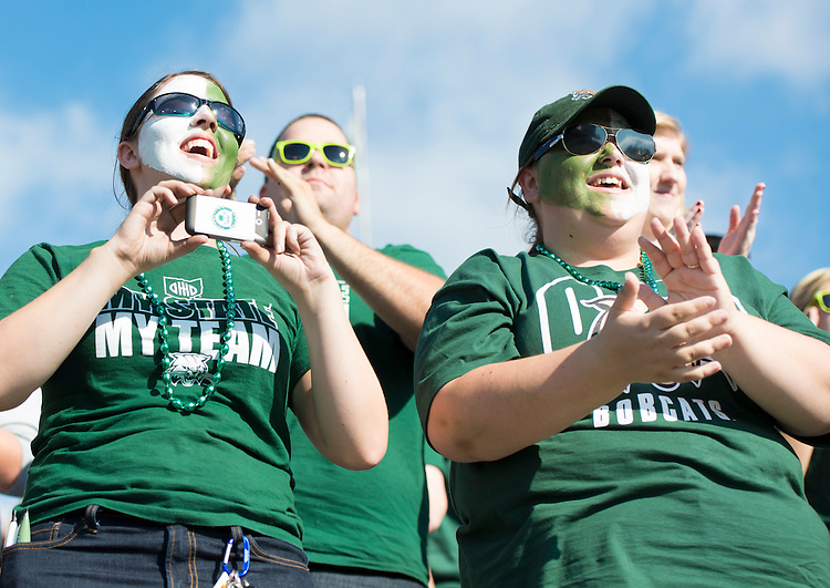 Fans cheer for the Ohio University Bobcats at the homecoming game which took place on Saturday, October 12, 2013. The Bobcats lost against the Central Michigan Chippewas 26 to 23.