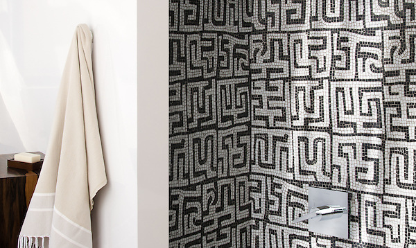 Kuba, a hand-chopped stone mosaic, is shown in tumbled Calacatta Tia and Nero Marquina, was designed by Sara Baldwin as part of the Legend Collection by New Ravenna.