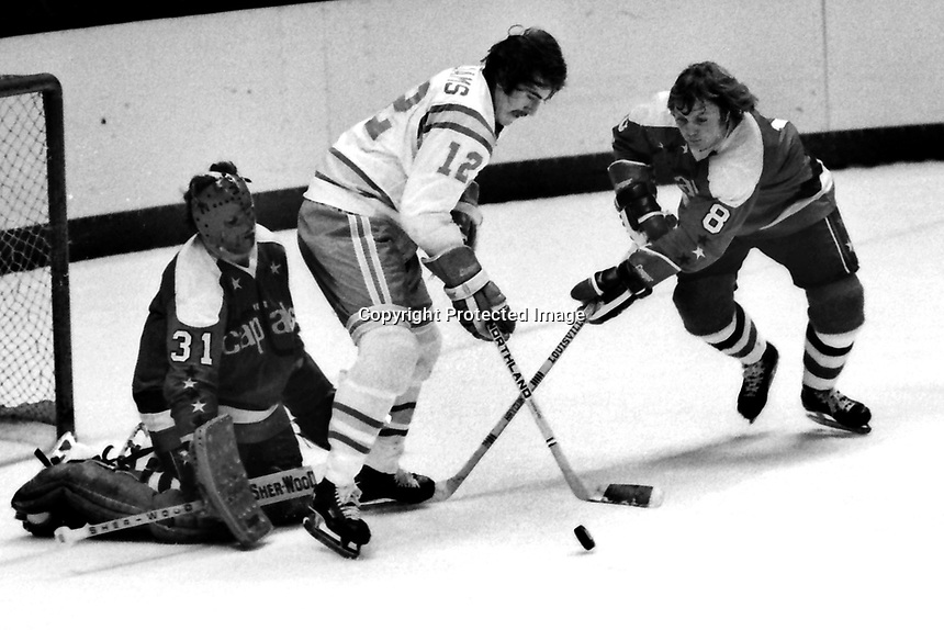 Seals vs Washington Capitols 1975 Seals Butch Williams in front of goalie Michel Belhumeur Capitols #8Don McLean.....{photo/Ron Riesterer)