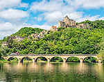 The village of Castelnaud-la-Chapelle, topped by the Château de Castelnaud, as seen from a boat on the Dordogne River. This Château was held by English forces during the Hundred Years' War.