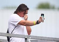 Jun 11, 2016; Englishtown, NJ, USA; NHRA fans react to the nitro methane fumes during qualifying for the Summernationals at Old Bridge Township Raceway Park. Mandatory Credit: Mark J. Rebilas-USA TODAY Sports