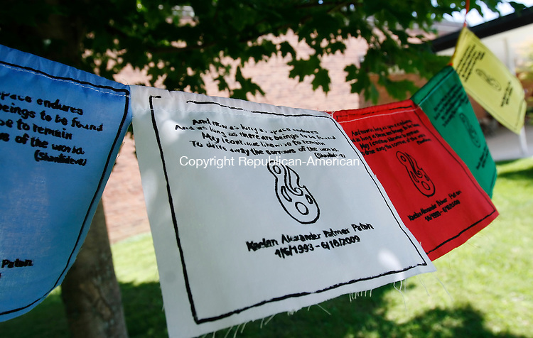 SHARON, CT 07/12/09- 071209BZ10- Prayer flags hang outside the Sharon Center School Sunday afternoon during a memorial service for Kaelan Paton who drowned June 16 after jumping into the Housatonic River trying to save a friend in peril.  They read: And now as long as space endures, And as long as there are beings to be found, May I continue likewise to remain To drive away the sorrows of the world. (Shantideva's)<br /> Jamison C. Bazinet Republican-American