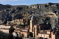 General view of Cathedral and Castle, Albarracin, Teruel, Spain, on February 13, 2006, pictured in the morning. The Cathedral, 1572-1600, was built by Martin de Castaneda, Pierres Vedel, and Alonso del Barrio de Ajo, in the Levantine Gothic style. At the top of the village is the 10th century Moorish castle, reached through cobbled streets of  houses constructed of wood and plaster with small windows. Albarracin, a beautiful village with National Monument status overlooking the Guadalivar River, lies 28 km from Teruel, in the National Park in the Montes Universales. It is on the border of three Spanish Kingdoms: Castille, Aragon and Valencia, has been occupied for hundreds of years and is known as the Eagles` Nest because it  is built on a steep outcrop of rock surrounded by a deep gorge, a natural defence. Its buildings show  Moorish influence and even the name may derive from  the Berber clan Banu Razin who settled in the area during the 9th century. Picture by Manuel Cohen.