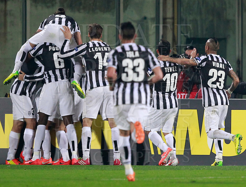 Calcio, ritorno degli ottavi di finale di Europa League: Fiorentina vs Juventus. Firenze, stadio Artemio Franchi, 20 marzo 2014. <br /> Juventus midfielder Andrea Pirlo is hidden by teammates celebrating after scoring the winning goal on a free kick during the Europa League round of 16 second leg football match between Fiorentina and Juventus at Florence's Artemio Franchi stadium, 20 March 2014. Juventus won 1-0 to advance to the quarter-finals.<br /> UPDATE IMAGES PRESS/Isabella Bonotto