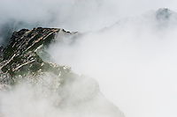 Cloud clings to the steep sides of Mount Karasawa, Nagano, Japan.