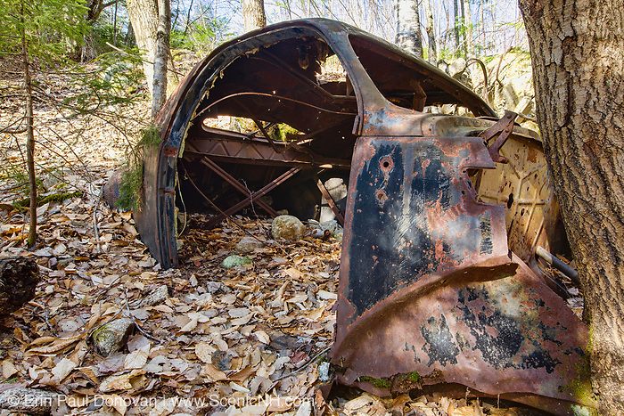 Abandoned old rusted car in the Tecumseh Brook drainage area of Waterville Valley, New Hampshire USA.