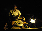 In this photo from 2007, Nurul Huda, a fisherman in the village of Olora on the Indonesian island of Nias, paddles at night to his fishing grounds in a boat provided by Church World Service. CWS and other members of the ACT Alliance helped families devastated by the 2004 tsunami and 2005 earthquake on Nias to rebuild their homes and their livelihoods.