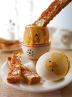 Decorated festive Easter eggs being eaten for breakfast