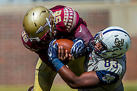 TALLAHASSEE, FLA 9/10/16-Florida State's Emmett Rice, left, battles for the ball with Charleston Southern tight end Qua-Vonn Scott during action Saturday at Doak Campbell Stadium in Tallahassee. <br /> COLIN HACKLEY PHOTO
