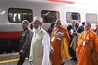 "Some of the 300 religious dignitaries disembark from the train upon arrival at Assisi station to attend the interreligious talks on October 27, 2011. Pope Benedict XVI will lead during the day the 25th Interreligious talks, a ""journey of reflection, dialogue and prayer for peace and justice in the world"" held in St. Francis of Assisi's birthplace,"