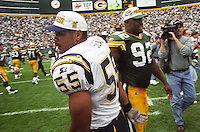 Junior Seau and Reggie White at the conclusion of the game in Lambeau Field