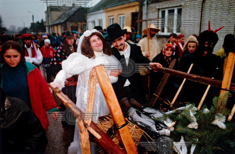 """The Bride and the Jew. The """"Decapitation of Death"""" takes place in the small town of Jedlinsk, in central Poland, every year on the Tuesday before Lent (Shrove Tuesday). Its exact origins are unclear, but it is believed to have begun in the 16th Century, and was first written by the local rector in 1839. The whole town gets involved in the theatrical pageant, and the words uttered by the main players, the Bride, Angel, Jew, Hangman, Devil and Bartholomew the Policeman, are well known among locals. It is believed that on this day Death gets drunk and loses its scythe, offering the perfect opportunity for him to be arrested and executed. After calls from the crowd, Death is sentenced to death, and a grand feast, marking the beginning of Lent, can begin."""