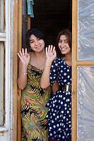 Uzbekistan, Bukhara. Girls waving at the photographer.