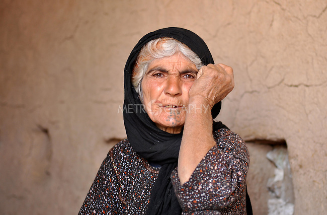 DOWDA, IRAQ:  An elderly Kurdish woman with traditional facial tattoos. ..Iraqi forces decimated the Dowda area in Germian during the 1988 Anfal genocidal campaign against the Kurds.  Daily life continues is this extremely harsh part of Iraq...Photo by Aram Karim/Metrography
