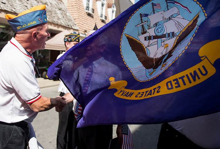 UNITED STATES - JULY 5: Keith Damron, left, member of the Sons of the American Legion, shakes hands with Rep. Nick Rahall, D-W.Va., before the presentation of the colors at the West Virginia Freedom Festival in downtown Logan, W. Va., on July 5, 2014. (Photo By Bill Clark/CQ Roll Call)