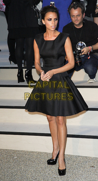 VICTORIA BECKHAM .Burberry Closing Party for London Fashion Week held at Chelsea College for Art & Design, London, England, UK, .September 22nd 2009..full length skirted dress sleeveless  patent high heels platform shoes .CAP/ROS.©Steve Ross/Capital Pictures