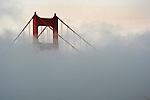 Fog surrounds the Golden Gate Bridge in San Francisco, California,