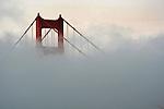 Fog surrounds the Golden Gate Bridge in San Francisco, California,