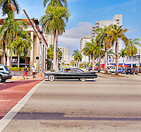 A black Cadillac Sedan de Ville from around 1960 on Collins Avenue in Miami Beach, Florida.