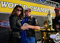 Nov. 10, 2012; Pomona, CA, USA: Pam Johnson wife of NHRA pro stock driver Allen Johnson joins in after her husband clinches the 2012 world championship during qualifying for the Auto Club Finals at at Auto Club Raceway at Pomona. Mandatory Credit: Mark J. Rebilas-