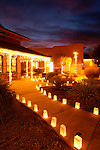 Luminarias and holiday lights line a walkway just before Christmas in Tubac, Arizona. Tubac is an historic arts and crafts village in southern Arizona.