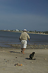 Marine Animal Rescue, walking with a rescued South American sea lion pup on the beach, Punta Colorada, Maldonado, Uruguay, South America
