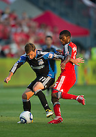 27 August 2011: Toronto FC defender Ashtone Morgan #5 and San Jose Earthquakes midfielder Joey Gjertsen #17 in action during a game between the San Jose Earthquakes and Toronto FC at BMO Field in Toronto.