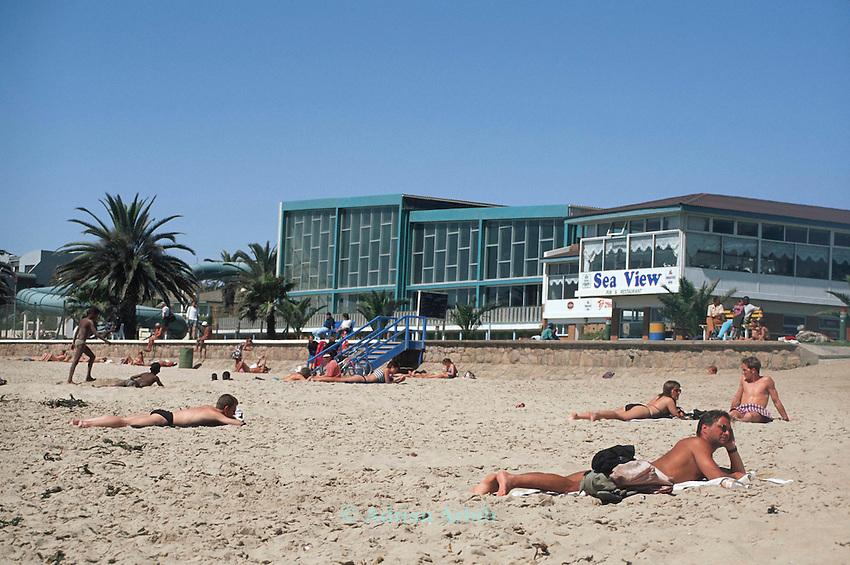 Sunbathers and  beach front at Swakopmund,  Namiba.