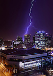Aug. 14, 2012; lightning bolt storm monsoon rain downtown Phoenix city skyscraper building office night US Airways Center Mandatory Credit: Mark J. Rebilas
