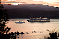 The Queen Elizabeth sails into Wellington Harbour at sunrise. The ship itself weighing 90,900 tons is as tall as a 21 story building and is the largest ship to date to arrive in Wellington Harbour