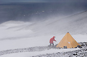 Cape Crozier, Antarctica is one of the windiest spots on earth. A scientist is tying the tent to lava rocks to it from blowing away.