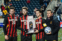 Maryland Terrapins forward Jake Pace (20) forward Patrick Mullins (15) midfielder Dan Metzger (7) and head coach Sasho Cirovski pose with the second place trophy. The Notre Dame Fighting Irish defeated the Maryland Terrapins 2-1 during the championship match of the division 1 2013 NCAA  Men's Soccer College Cup at PPL Park in Chester, PA, on December 15, 2013.