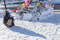 A woman and a kid look at signs and flowers outside the Grande Mosquée de Quebec (Centre Culturel Islamique de Quebec), Thursday February 2, 2017. Sunday January 29, a shooter left six worshippers dead at this Quebec city mosque.