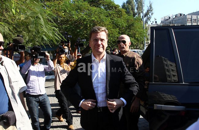 German Foreign Minister , Guiido Westerwelle  visits a United Nations Relief and Works Agency (UNRWA) school in Gaza City, Nov. 8, 2010. Visting German Foreign Minister Guiido Westerwelle on Monday called for the lifting of Israel's blockade on the Gaza Strip, saying that the blockade 'supports extremism and weakens the moderates . Photo by Ashraf Amra