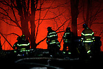 Waterbury, CT- 01 December 2016-123116CM07-  Waterbury firefighters battle a blaze at a former storage facility near the intersection of South Main Street and Pearl Lake Road in Waterbury on Saturday night.   Christopher Massa Republican-American