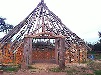 BNPS.co.uk (01202 558833)<br /> Pic: UpcottRoundhouse/BNPS<br /> <br /> Yabba-dabba-doo...<br /> <br /> Sawn log walls.<br /> <br /> A farmer has painstakingly recreated an Iron Age roundhouse to enable holidaymakers to release their inner Flintstone in the heart of the Devon countryside.<br /> <br /> Charles Cole has gone back over 2000 years to offer a back to basic's experience including a stone hearth fire, rudimentary plumbing, composting toilet and a six ton thatched roof to keep out the wind and rain.<br /> <br /> The amazing structure has been completely hand built by Charles and his family from materials sourced from their own farm and they have just opened up for bookings at &pound;170 a night.