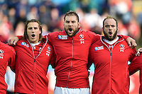 Jeff Hassler, Jeff Sinclair and Doug Wooldridge of Canada sing their national anthem prior to the match. Rugby World Cup Pool D match between Canada and Romania on October 6, 2015 at Leicester City Stadium in Leicester, England. Photo by: Patrick Khachfe / Onside Images