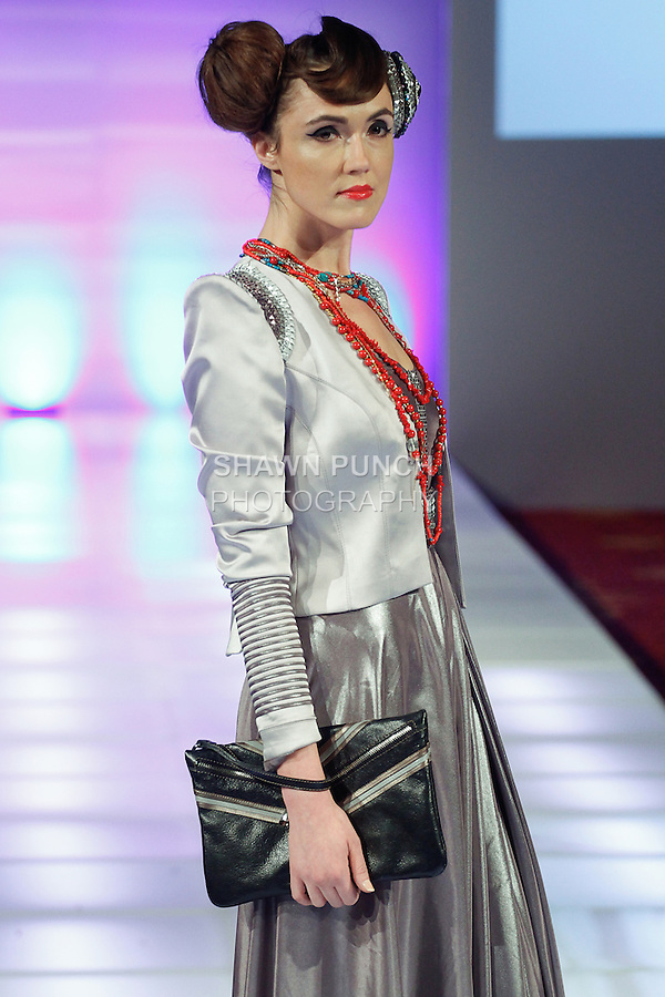 Model walks runway in an outfit from the Otgoo Couture collection by Mongolian fashion designer Otgonjargal Demberelsuren, during Couture Fashion Week Fall 2014, on February 14, 2014.