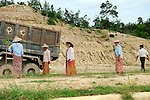 "Burmese workers forced to work on the Naypyidaw highway. Men, women, even children, whole families are called up to achieve what the junta calls Working for the country"". They are compelled to work from sunrise to nightfall watched by guards, under strict surveillance."