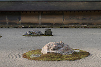 The Ryoan-Ji temple garden consists of a flat, rectangular surface of raked white sand with fifteen rocks scattered about singly and in clusters and surrounded by moss