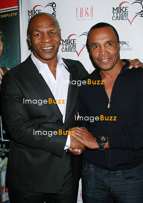 Mike Tyson and Sugar Ray celebrate the official launch of Mike Tyson Cares Foundation at Tabu Lounge in Las Vegas. December 7, 2012.