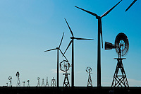 A collection of diminuative antique windmills stand below modern wind turbines on the open plains north of Springfield and Vilas, Colo. The Vilas school district has answered rural needs and saved its own declining student population by putting he school online to serve remote students around the state. The district has also attracted the scrutiny of state officials.