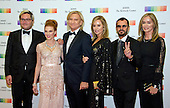 Joe Walsh of the rock band &quot;The Eagles&quot; and his wife,  Marjorie, arrive for the formal Artist's Dinner honoring the recipients of the 39th Annual Kennedy Center Honors hosted by United States Secretary of State John F. Kerry at the U.S. Department of State in Washington, D.C. on Saturday, December 3, 2016. The 2016 honorees are: Argentine pianist Martha Argerich; rock band the Eagles; screen and stage actor Al Pacino; gospel and blues singer Mavis Staples; and musician James Taylor.  From left to right:  Christian Quilici, unidentified, Joe Walsh, Marjorie Walsh, Ringo Starr, and Barbara Bach.<br /> Credit: Ron Sachs / Pool via CNP