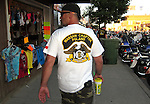 STURGIS, SOUTH DAKOTA - AUGUST 2010:  A motorcyclist from Warsaw, Poland walks on Main Street in downtown Sturgis, South Dakota during the 70th annual Sturgis Motorcycle Rally held in the Black Hills.  The attendance estimates were placed between 500, 000 and 700,000 bikers.