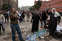 Volunteers man a water station for anti-Hosni Mubarak protesters as they clash with nearby Mubarak supporters in the Tahrir square area February 03, 2011  in Cairo, Egypt. Supply lines for the protesters in the square are able to provide some food, water, medical aid and newspapers to the large crowds there. . .Photo by Scott Nelson