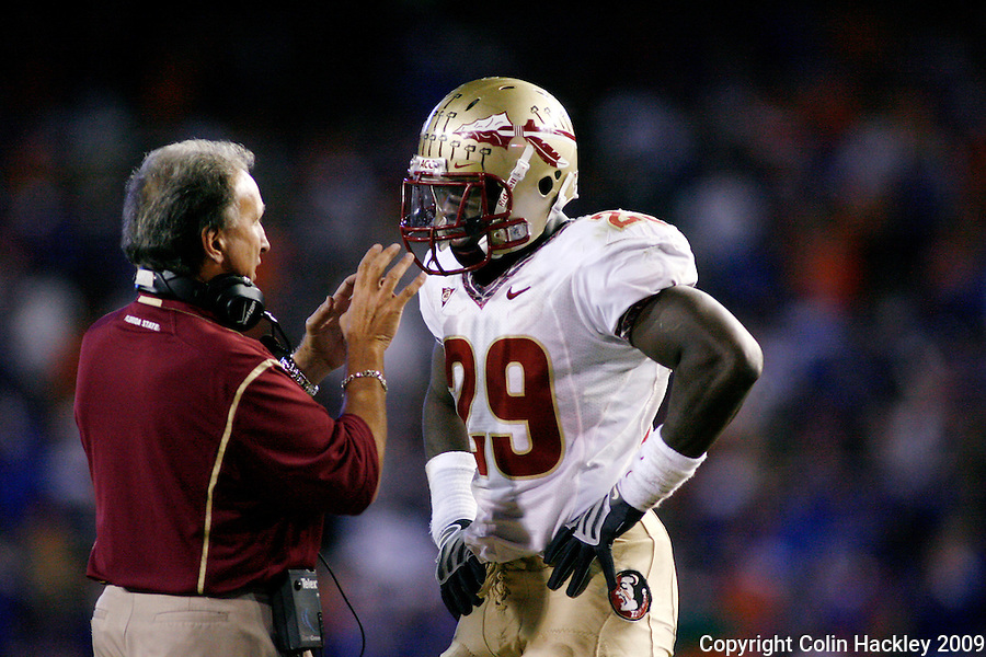 GAINESVILLE, FL 11/28/09-FSU-UF FB09 CH48-Florida State Linebackers Coach Chuck Amato directs Kendall Smith during a timeout against Florida during second half action Saturday at Florida Field in Gainesville. The Gators beat the Seminoles 37-10..COLIN HACKLEY PHOTO