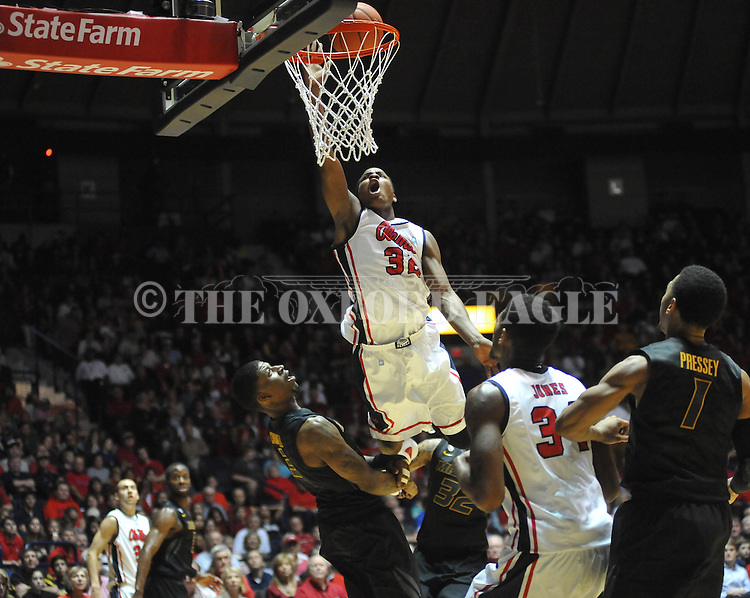 "Ole Miss' Jarvis Summers (32) is fouled by Missouri's Tony Criswell (3) at the C.M. ""Tad"" Smith Coliseum on Saturday, January 12, 2013. Ole Miss defeated #10 ranked Missouri 64-49."
