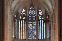 The high stained glass windows of the apse, with the central section dating from the 13th century, above the chapel our Lady of the drapers, in the Basilique Cathedrale Notre-Dame d'Amiens or Cathedral Basilica of Our Lady of Amiens, built 1220-70 in Gothic style, Amiens, Picardy, France. Amiens Cathedral was listed as a UNESCO World Heritage Site in 1981. Picture by Manuel Cohen