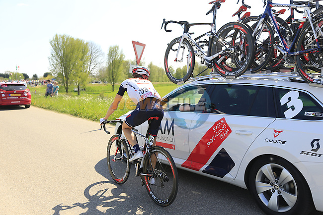 Marcel Wyss (SUI) chats with the team car as they cross a dike during Stage 2 of the 2016 Giro d'Italia running 190km from Arnhem to Nijmegen, The Nethrerlands. 7th May 2016.<br />