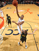 Dec. 17, 2010; Charlottesville, VA, USA; Virginia Cavaliers forward Akil Mitchell (25) shoots the ball over Oregon Ducks forward E.J. Singler (25) during the game at the John Paul Jones Arena. Virginia won 63-48. Mandatory Credit: Andrew Shurtleff-